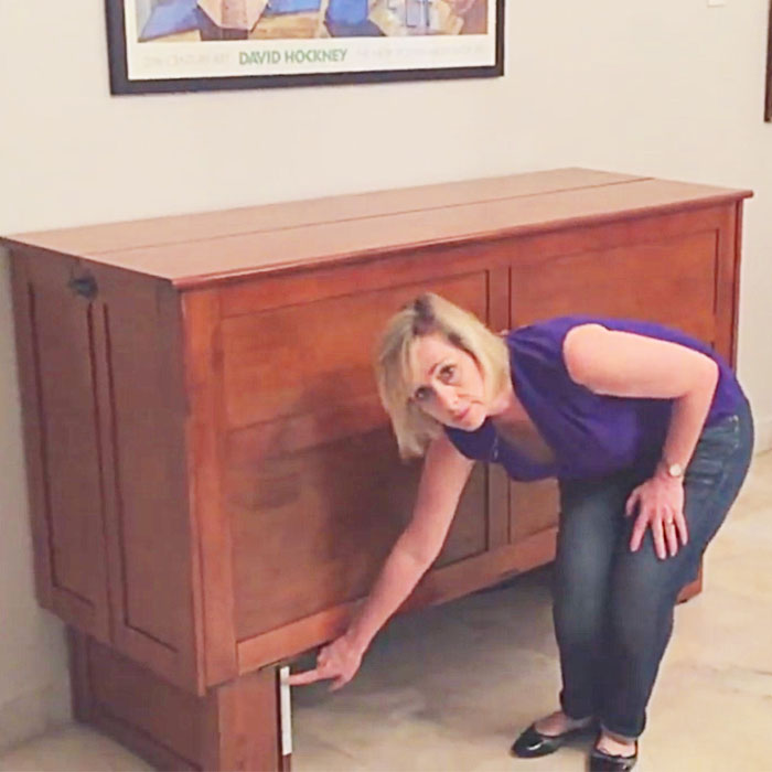 This cabinet will turn in to a bed in seconds