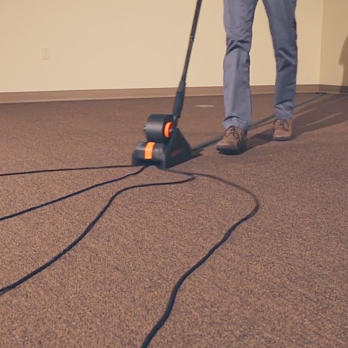 Automatically Tapes Down Cords To Your Floor