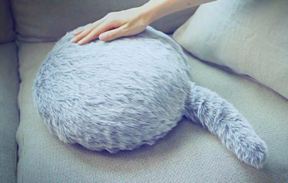 Qoobo: A Robotic Fake Cat That Wags Its Tail