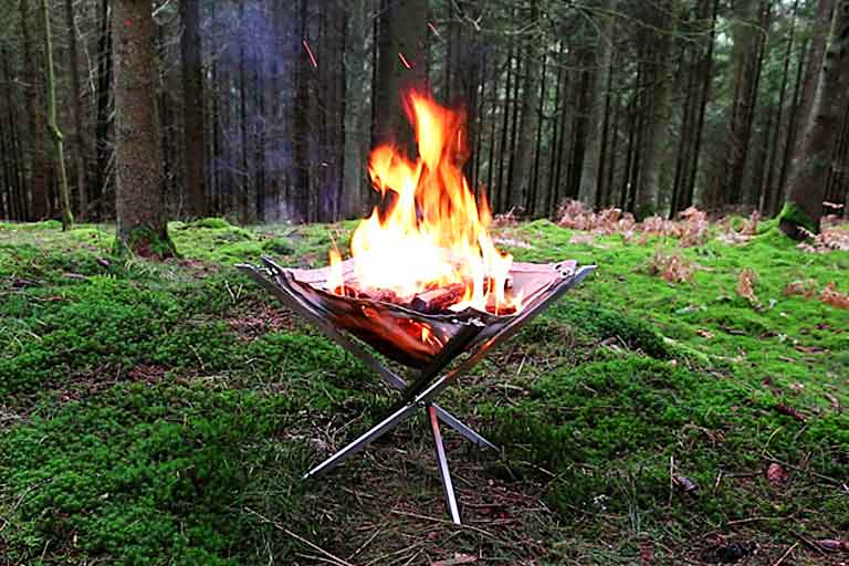fire pit takes wood fire and grilling anywhere