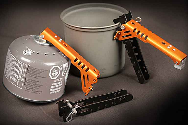 pot gripper also punctures fuel canisters for safe recycling